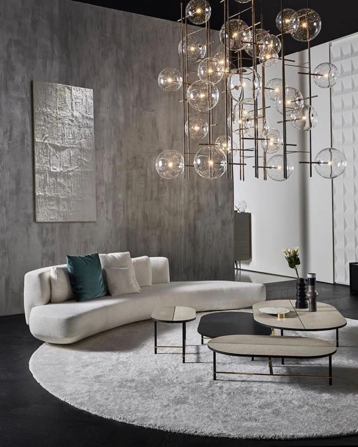 Grey Wall Black Wooden Floor White Couch Small Wooden Coffee Tables Hanging Chandelier In 2020 Minimalist Living Room Black Furniture Living Room Living Room Makeover