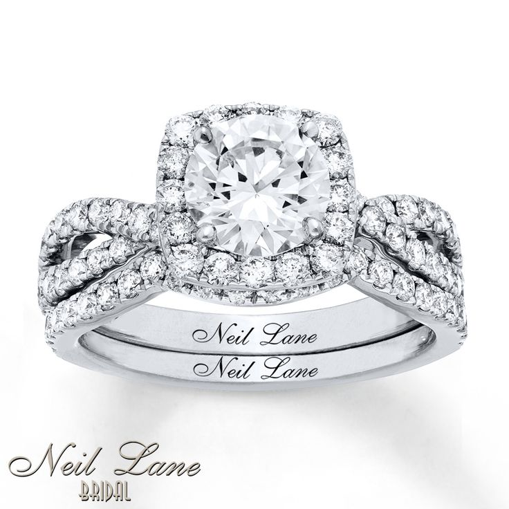 PERFECTION! My absolute favorite shape and cut combo!  Round diamond in a square halo with a twisted, split shank!
