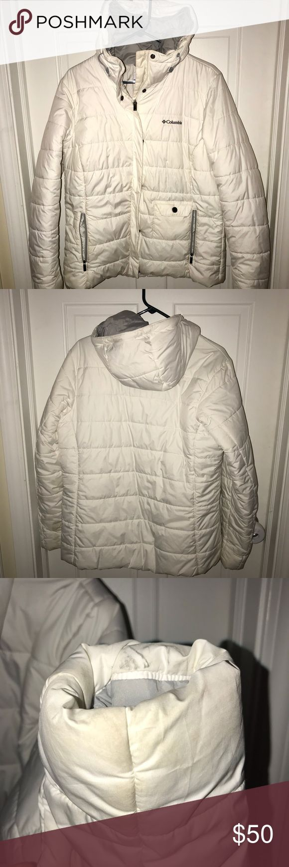 Columbia Women's Large White Winter Coat Beautiful and warm Columbia winter coat. Worn one winter, has discoloration on arm/wrist area from clearing off a slushy car, small makeup mark near neck area. Stains have not been washed or treated, they may come out. Over all beautiful condition, fully functional and I would continue wearing it if it still fit me! Columbia Jackets & Coats Puffers