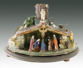 Extremely rare German paper mache rotating tree stand depicting the nativity