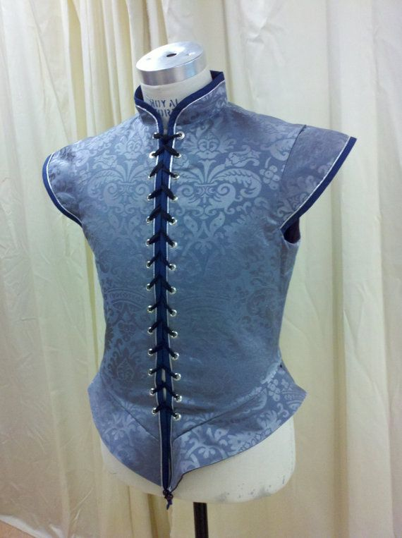 Oh look, a blue doublet. We could put a blouse under this so that the characters do not go shirtless while doing their onstage changing. Although the tying of this particular doublet makes me nervous.  Light Blue Renaissance Men's Brocade Doublet for by silverstah, $125.00