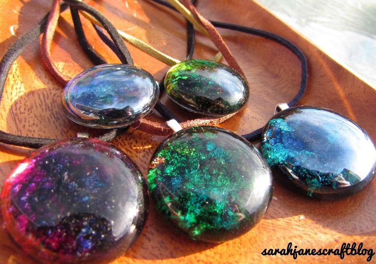 DIY craft tutorial for alcohol Ink decorated glass gem flat marbles backed with foil tape and made into pendants.