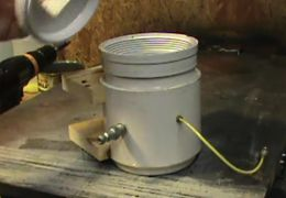 Resin Casting Pressure Pot - Homemade resin casting pressure pot constructed from PVC pipe and end cap, a quick disconnect fitting, tire valve, hose, and lumber.