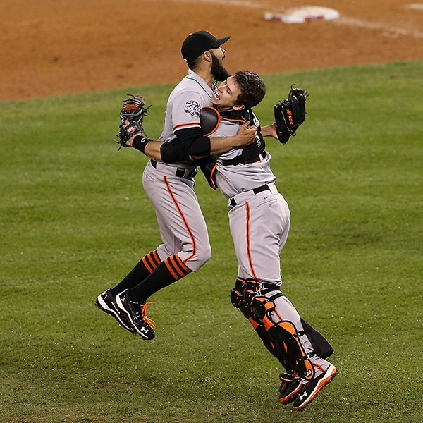 OCTOBER 28: GIANT KILLER -- Giants catcher Buster Posey rushed out to greet Sergio Romo after the closer struck out hulking Tigers slugger Miguel Cabrera in the 10th inning of Game 4 of the World Series in Detroit. By fanning the American League MVP (and baseball's first Triple Crown winner in 45 years), Romo completed a sweep that delivered the Giants their second World Series crown in three years. (Photo by Christian Petersen/Getty Images)