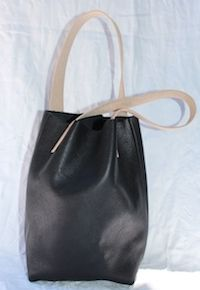 Black Italian Leather, with Sabe leather straps that turn a warm honey colour in time, $89