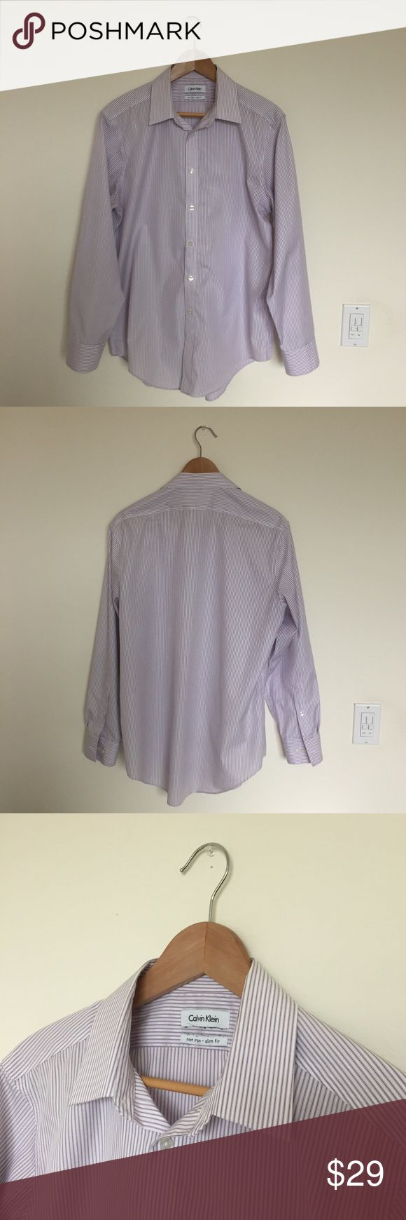 Mens Calvin Klein Striped Non-Iron Dress Shirt This slim fit dress shirt has a plum striped pattern and advanced non-iron fabric that balances temperature and wicks moisture for cool, dry comfort. Size 16 32/33 Calvin Klein Shirts Dress Shirts