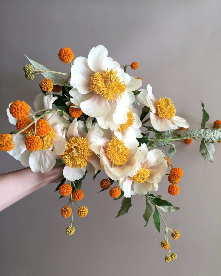 beautiful bouquet with a pop of orange