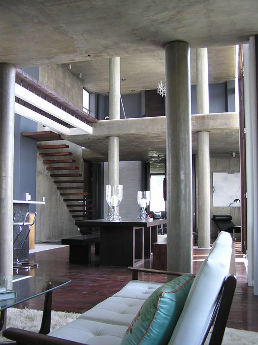 House Joubert - This house in Waterkloof Ridge, Pretoria the ultra plush zenith of a party destination, pushes out the frontlines of contemporary concrete minimalism.