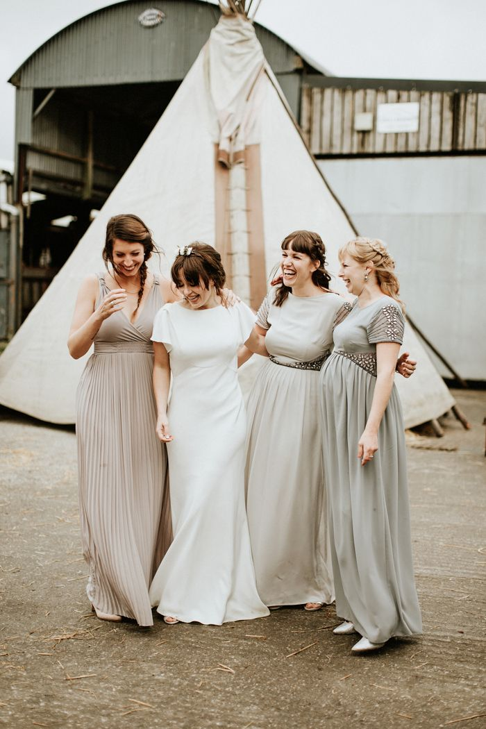 The charming bridesmaids from this rustic Welsh wedding prove that you can't go wrong with neutral toned bridesmaid gowns  | Image by  Lauren Scotti Photography