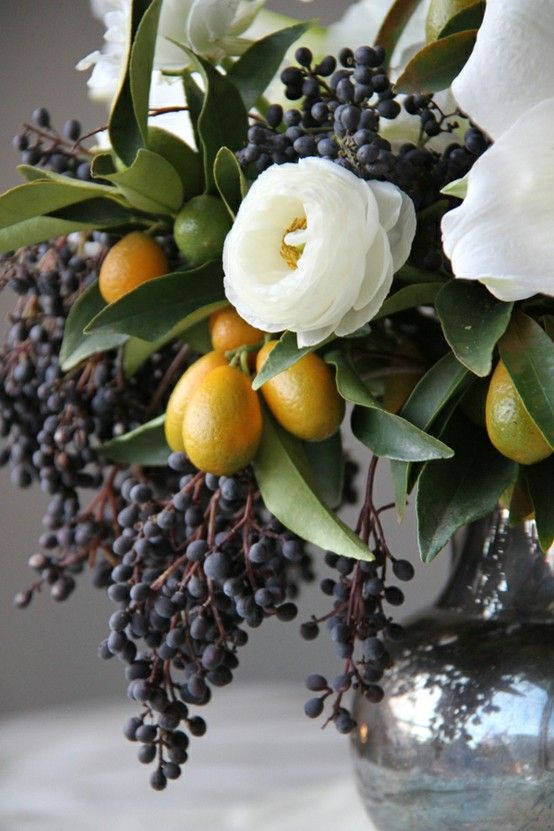 If I could get married again and have a summer wedding... this would be the decor inspiration. privet berry, kumquat & ranunculus