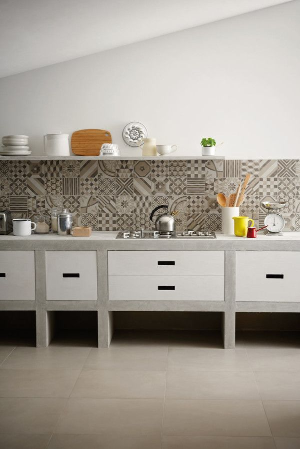 Italian tile manufacturer Marazzi designed this kitchen with their Block monochromatic mosaic tile in various graphic patterns.