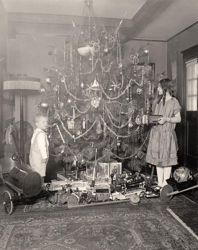 Vintage Christmas....I don't know the year but this must be pretty old going by the toys and the girl's hair do and dress