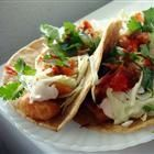 Fish Tacos!  made these for dinner tonight......short cuts....used frozen cod and coleslaw mix!   Sauce and fresh lime are the key.   made fresh pico de gallo to top it off!