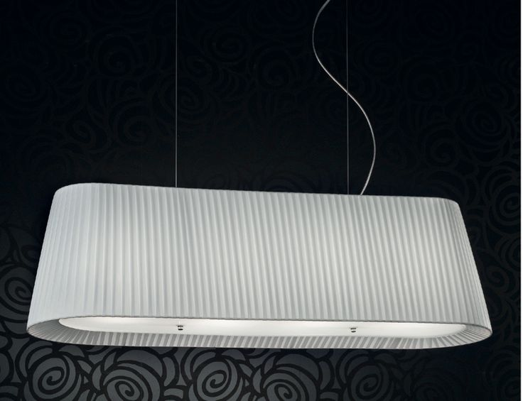 Oblong light with white fabric. Simple diffuser underneath. Ideal to hang low or high over a table. Simply elegant. Very attractive 'return' of the fabric towards the light diffuser.