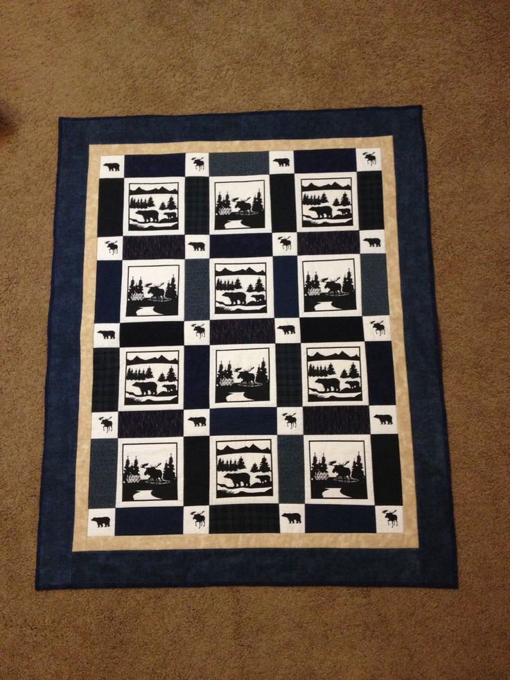 Moose and Bear lap quilt in flannels.