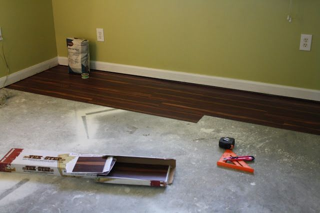 Thrifty Flooring using sticky tiles