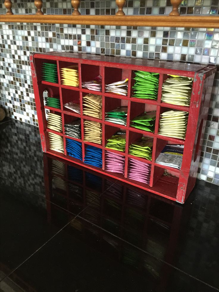 Tea bag storage using an old Coca Cola crate