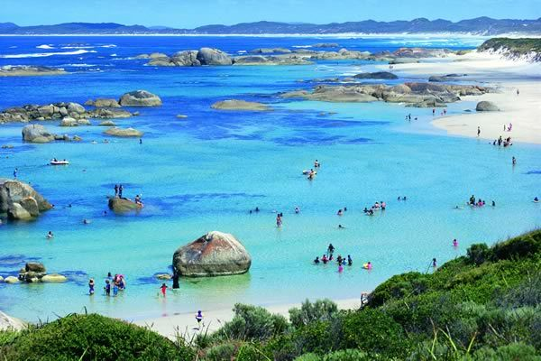 Swimmers in Greens Pool, located in William Bay National Park, near Denmark, Western Australia