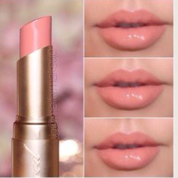 "Two Faced ""naked dolly"" lipstick  Lovely nude lipstick by Two Faced in the shade Naked Dolly. I've used a few times, and loved the results. It is a nude shade with a tiny hint of pink. Two faced products can be a bit pricy.. Feel free to make me offers any time Two faced Makeup Lipstick"