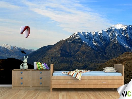 A wall mural of a paraglider soaring past the Remarkables in Queenstown, New Zealand.