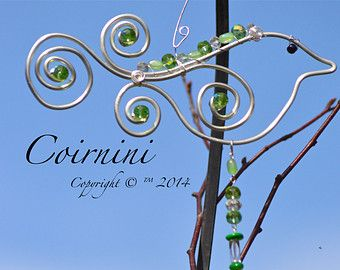 SUNCATCHERS WITH MEANING: Bird Suncatchers I feel that animals know how to make life better, they are our angels on this earth. Lets keep an everlasting love for them with a Wire Wrapped Suncatcher You will love Coirninis Sun Jewels, they are gorgeous in a window, hang your sun-catcher at that special place you love to sit. Coirninis sun-catchers are stunning! Wire Art that has been handcrafted using silver or copper wire which has been shaped intricately to create exquisite art for you and…