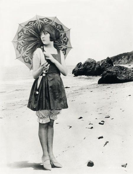 Flapper bathing suit parasol at ocean