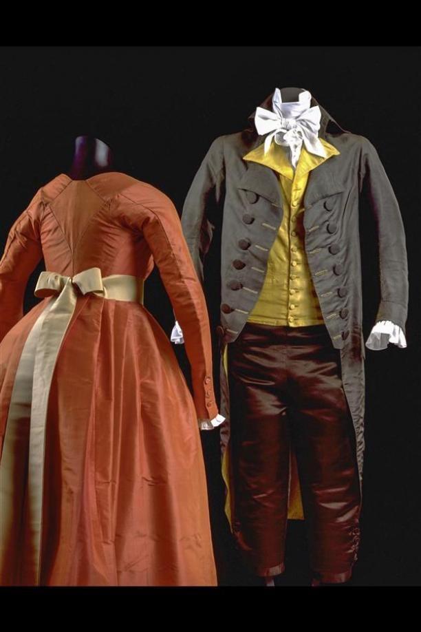Rear view, dress, c. 1793. Orange silk taffeta, cream silk ribbon.
