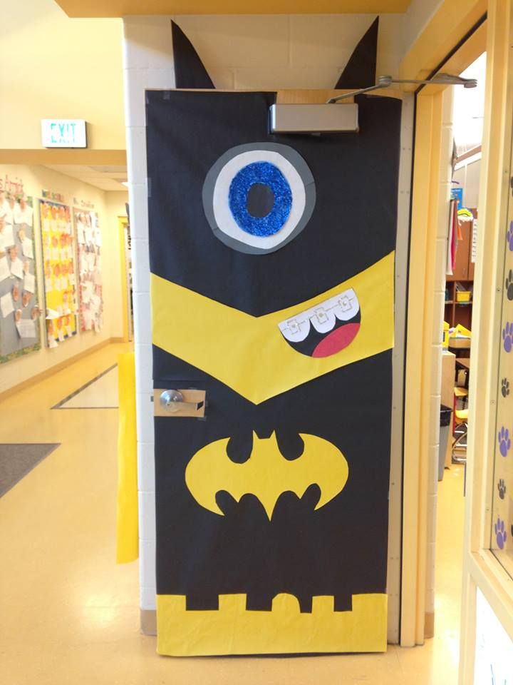 A door decoration I made for our first grade superhero writing celebration. A minion in a batman suit!