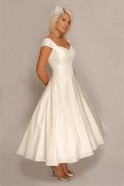 I love this dress. Simple. Perfect. Easy to 'jack up' with some bright shoes and a cute sash! Definite favorite so far!