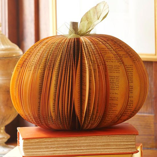 Turn an old book into a Unique Paper #Pumpkin Centerpiece. Learn how here: http://www.bhg.com/thanksgiving/crafts/colorful-simple-fall-projects/