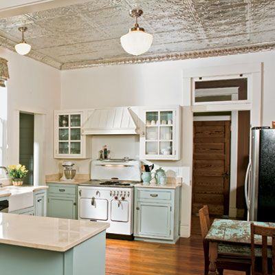 There is so much to love about this kitchen! From the tin ceiling to the old stove, wood floors, sink and cabinets!