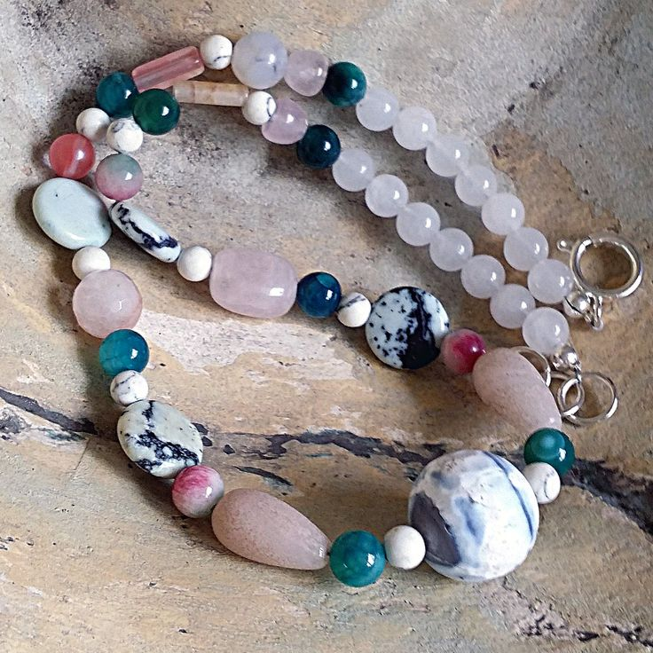 Handcrafted Single Strand Agate and Mixed Gemstones Necklace (46cm, 18.11 inches).  This colourful handmade necklace is inspired by the beach and ocean. I have used a variety of beautiful gemstones in this necklace. The focal bead is a large 20mm (0.78In) faceted Agate round bead. Other gemstones in this necklace are: coin Jasper, natural Stone, Tourmaline, green Agate, white Turquoise, Pink Quartz, white Crystal. The Necklace has a 14mm (0.57In) metal clasp.   All my jewellery is unique and…