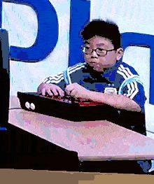Button mashing. Fighting games. Asian kid gone crazy lol. Hilarious gif.