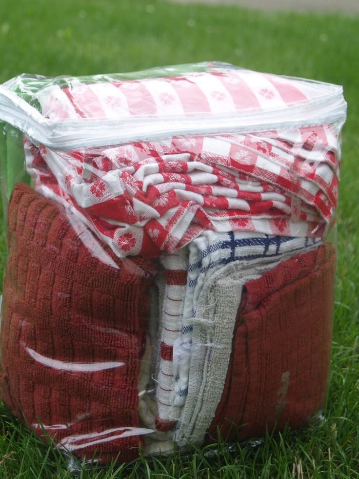 buy the Dollar Store bedding bags to keep towels, etc together, and keep camp dust off..great idea for emergency kit storage, too!