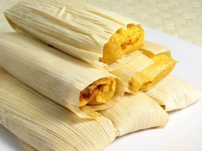 Mexican Tamales (MY FAVE not easy to make) - You Will Need: 6 ears fresh corn on the cob with husks intact; 3 cups tortilla flour; 1 cup shortening; 2 tablespoons sugar; 1 teaspoon baking powder; 1 teaspoon salt; ½ cup fresh hot chili peppers, chopped fine; 2 cups Monterey Jack cheese, shredded; 2 cups cheddar cheese, shredded