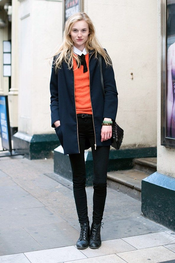 Orange top with black skinny jeans