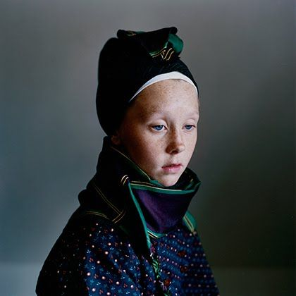 """Trine Søndergaard's photo series, """"Strude,"""" The headgear worn is called a #strude worn in #Fano #Denmark and some centuries ago, in the pre-Goretex era, its function was to protect the faces of Danish women against the brutal elements of Northern Europe. Trine traveled back to #Fanø and photographed a bunch of ladies wearing their ancestors threads."""