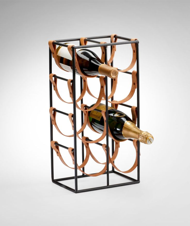 Esquire Leather Wine Holder: Sturdy and industrial with vintage appeal. The frame is finely crafted of iron with with a raw steel finish. Real cowhide leather straps securely cradle bottles with a unique suspended design. The Esquire Leather Wine holder is available in an eight-bottle, five-bottle, or four-bottle configuration. The Esquire Leather Wine Holder is an excellent gift for the sophisticated host or hostess, or the defining touch to your modern home bar. $55.00–$92.50