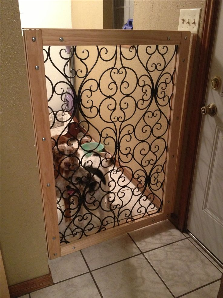My 4 yr old  Australian Shepard decided to start jumping the baby gate that she had used since she was a puppy. So we built a new 48 in. gate from two wall hangings that I purchased at hobby lobby and framed them in with pine boards, metal straps and bolts. I am going to paint the trim the same color as the laundry room once i decide on colors. I love it. Much nicer than the 30 dollar baby gate we had.