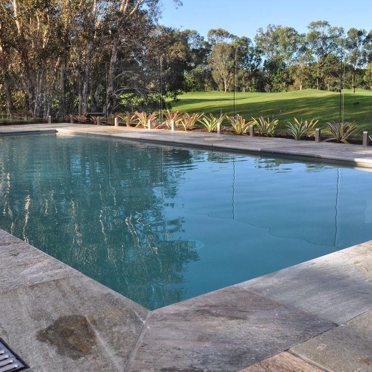 Stone paving and glass pool fencing at Twin Waters.