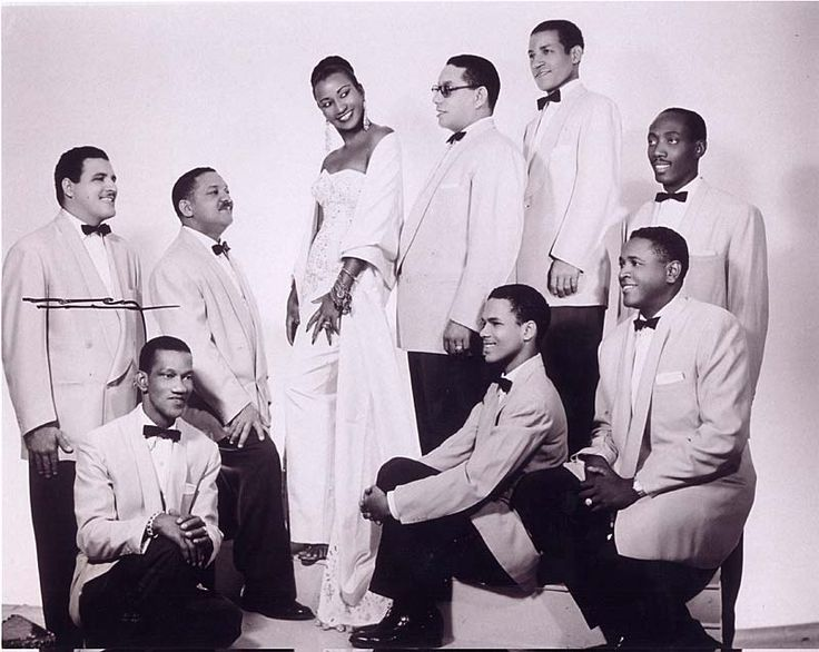 Celia Cruz with La Sonora Matancera, Cuba's most popular orchestra, in the 1950s. Ms. Cruz was the lead singer of the group and eventually married the trumpet player from the group, Pedro Knight. Photo by Narcy Studios, Cuba, courtesy of Omer-Pardillo Cid.