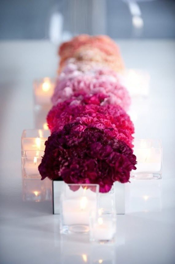pink ombre floral centerpiece // tablescape  Carnations in shades of pink are individually set in mirrored vases and placed in ombre pattern down the center of the table.