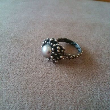 This #Jellyfish #Polyp #cultured #pearl #ring was inspired by by recent fascination with the state of our global waters, and the 1000's of species of jellyfish that are taking over. This #ringwas lovingly #handcarved by #Tara Shelton and cast into #sterling silver. Price $275.00 CDN. See more of #artisan Tara Shelton's #jewelry #jewellery at #ArtisansAtWork/ #AAWGallery www.aawgallery.com and www.tarashelton.com