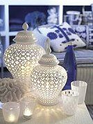 Enhance a serence setting with the diffused lighting created through the delicate pierced design of these porcelain lanterns. SMALL PIERCED COVERED LANTERN-FUN novelty lighting coastal seaside cottage decorating