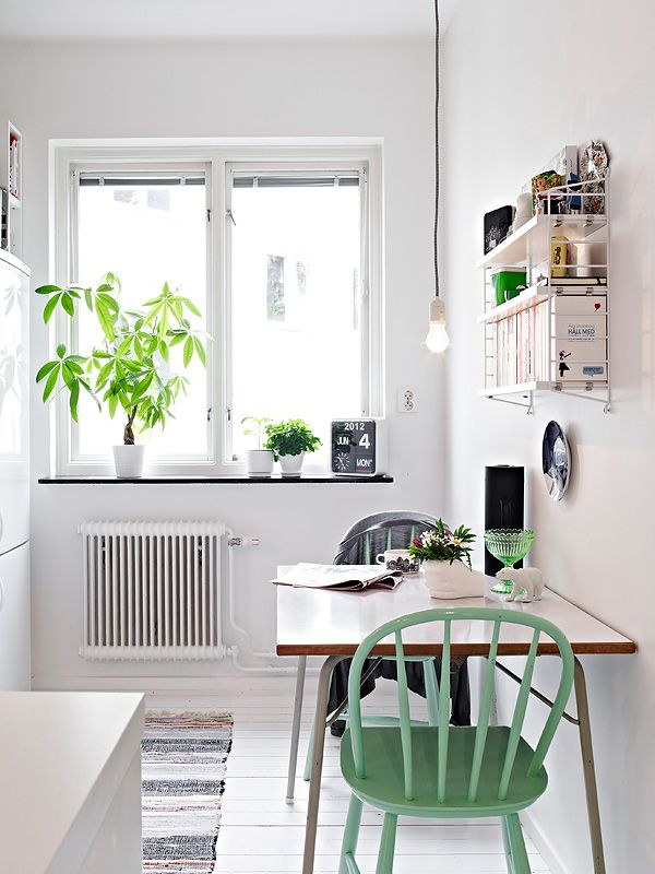 Open up a tight space with the right color strategy. Mostly white with a pop of fresh mint.