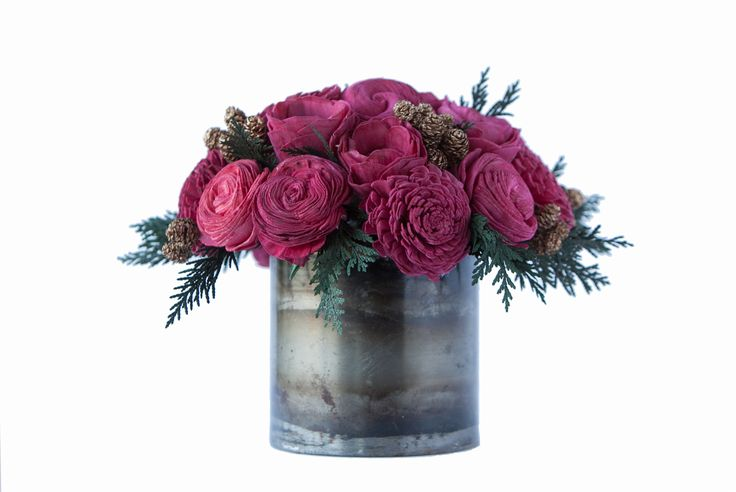 $60 {In Stock}  Christmas Cheer This traditional holiday sola flower arrangement is a beautiful mix of preserved cedar, gold pinecones and red sola flowers in a metal container.  Use it as a single centerpiece or order multiples to line your table.