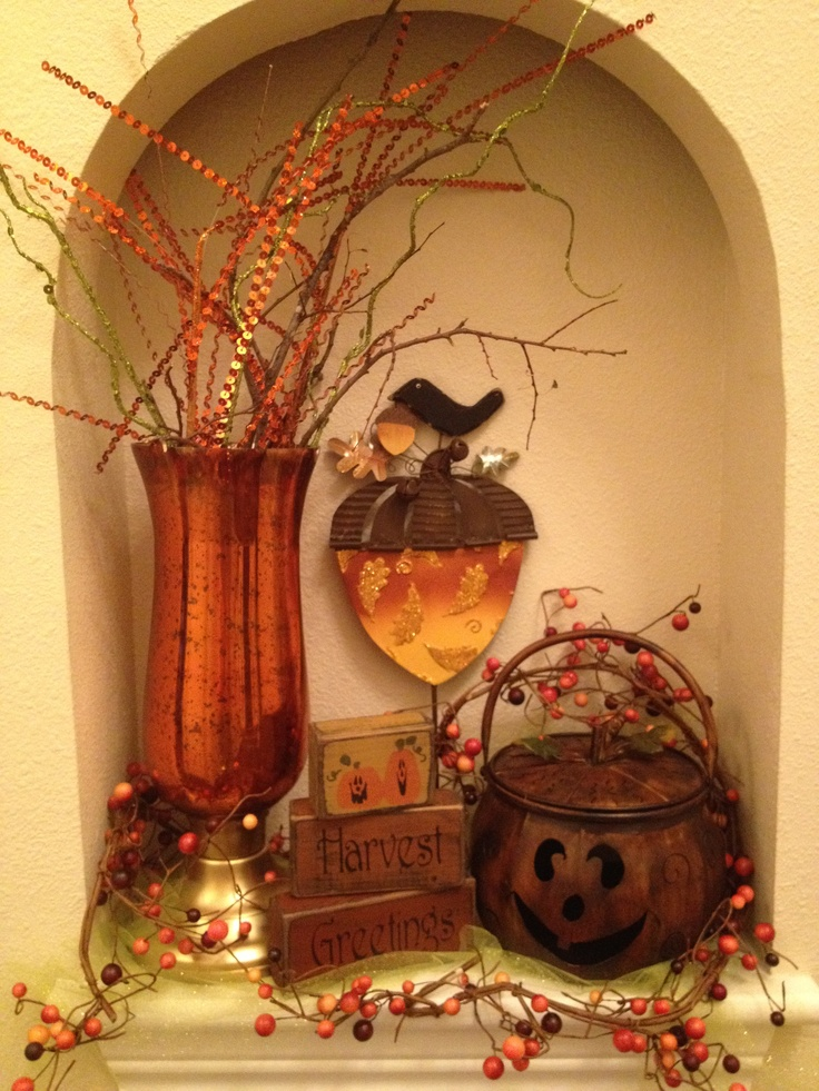 Fall niche.   You could do this for that opening in hallway and change it every month or holiday season!?!