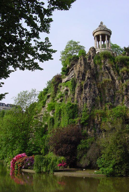 """Buttes Chaumont: a whimsical park found in the 19th arrondissement of Paris. Here you can nestle into a crevice on a steep hill or spread out with a big group for an evening movie """"en plein air."""" And if you forget your picnic basket, you can find a bottle and some goodies at Rosa Bonheur, """"sur la place"""" or """"emporter.""""   http://www.rosabonheur.fr/"""