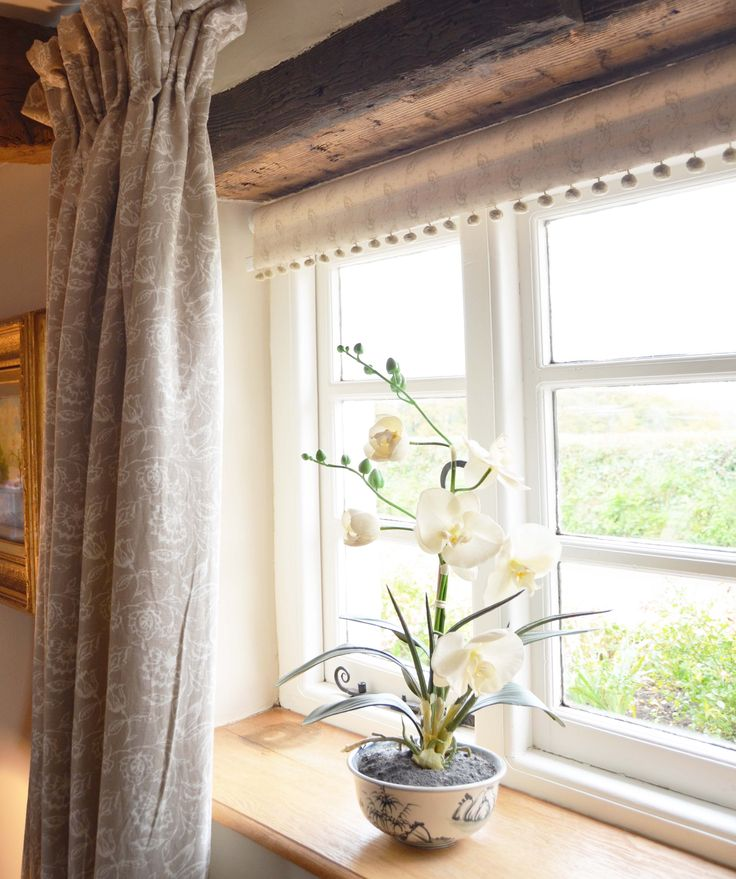 Curtains beige, blind with pompoms www.suescammellinteriors.co.uk