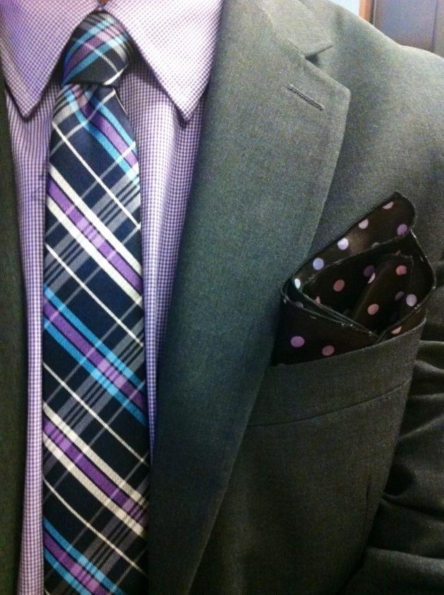 A purple polka dot pocket square creates a fun and festive look.
